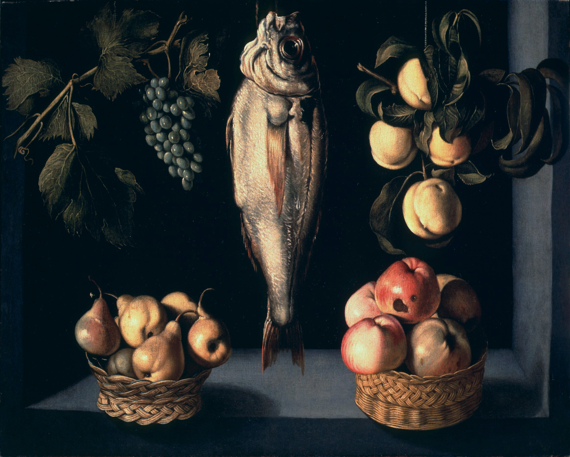 Still Life in a casement with a basket of pears and apples, a Haddock, Vine stem and a branch of peaches